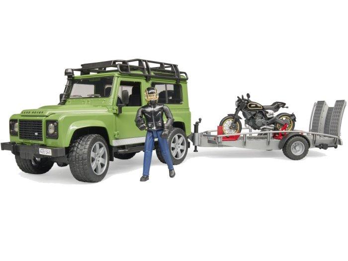 Zabawka Land Rover Defender Station Wagon z motocyklem Ducati Scrambler Caffe i figurką