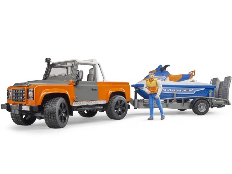 Zabawka samochód Land Rover Defender Station Wagon z przyczepą, skuterem wodnym i figurką foto 1